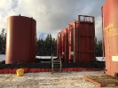400 bbl sloped lined tanks with manifold and hoses in lined containment